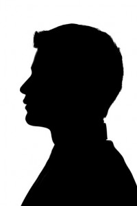 Profile of a young man in silhouette.